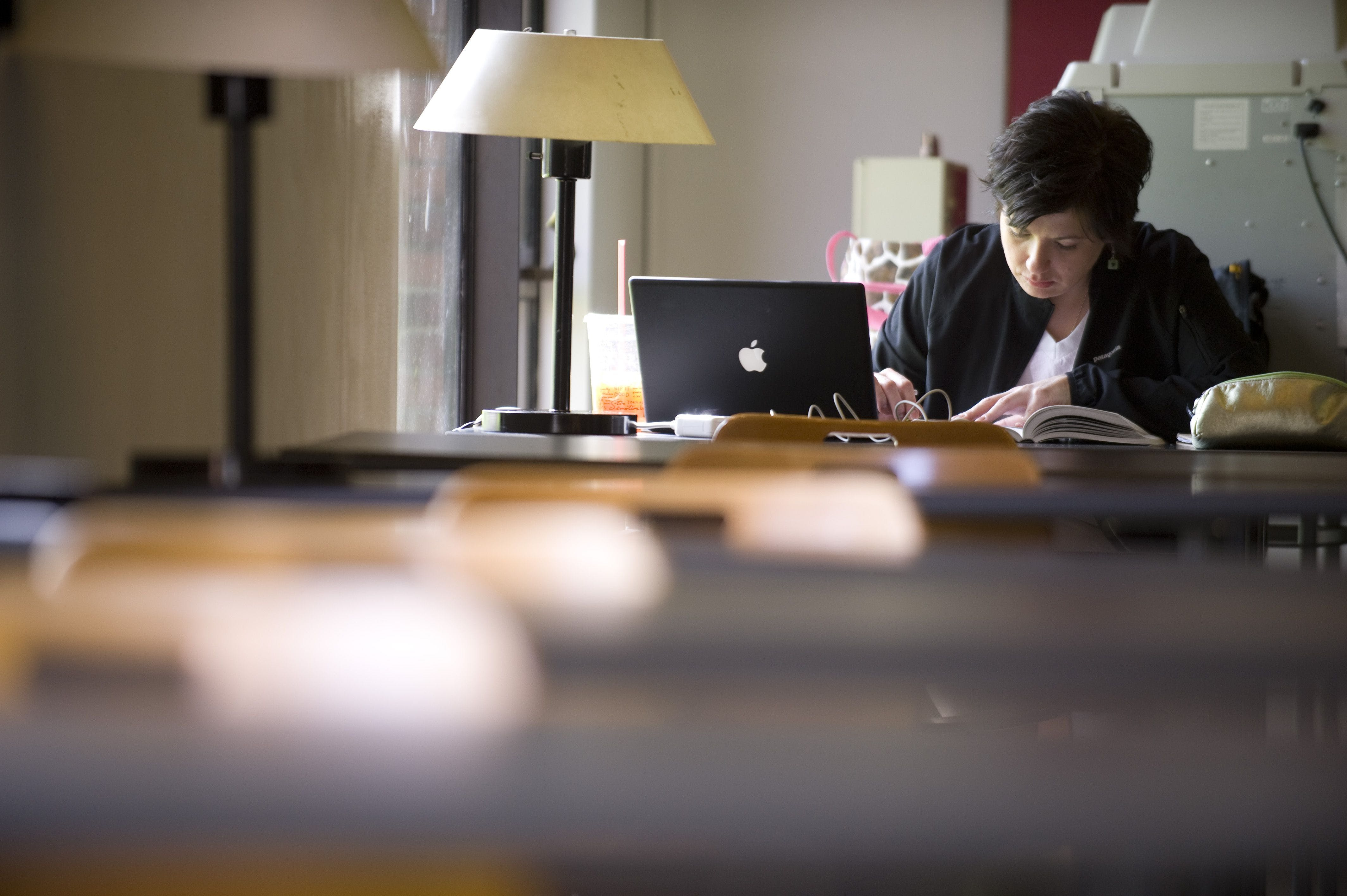 A seminary student works on her computer.