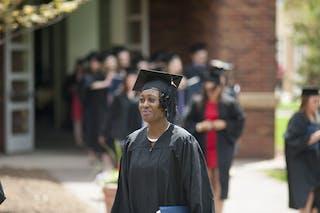 An adult undergrad student on graduation day.