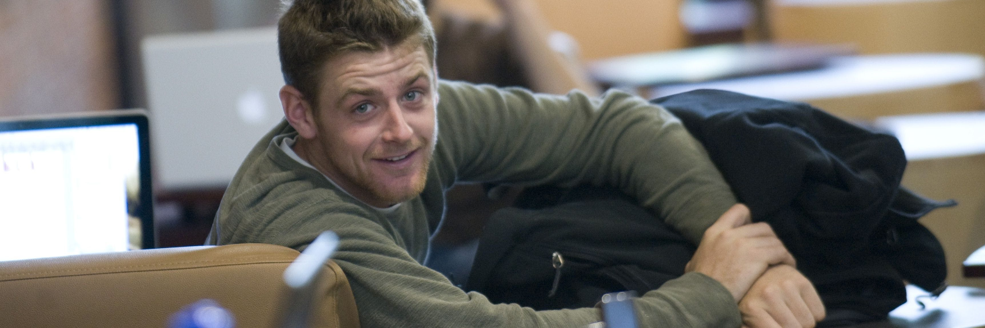 A student smiles in Brushaber Commons.