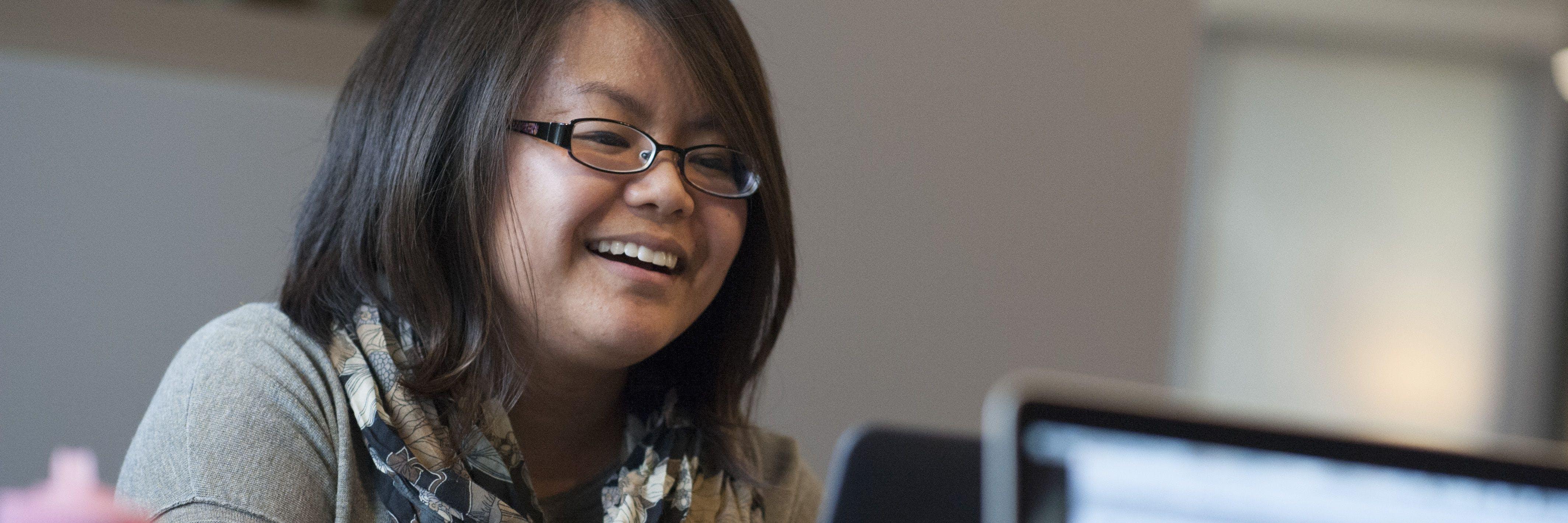 Adult undergrad student studies on computer.