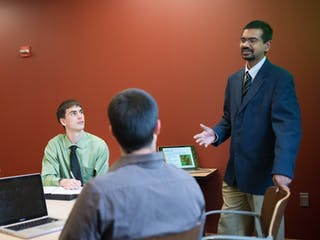 Bethel students working with a professor