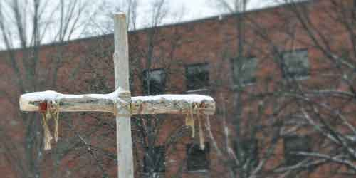 Cross in the snow on campus