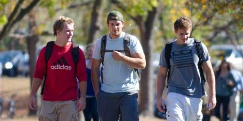 Students walking together across campus