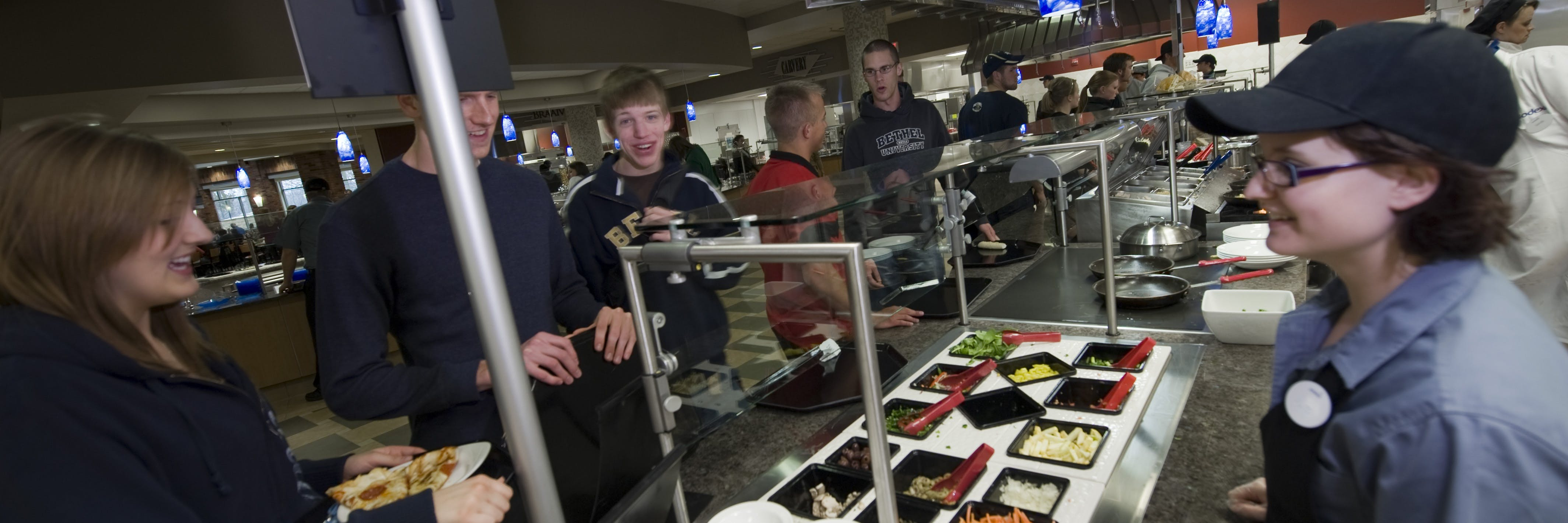 Students waiting in line for pasta in the dining center.