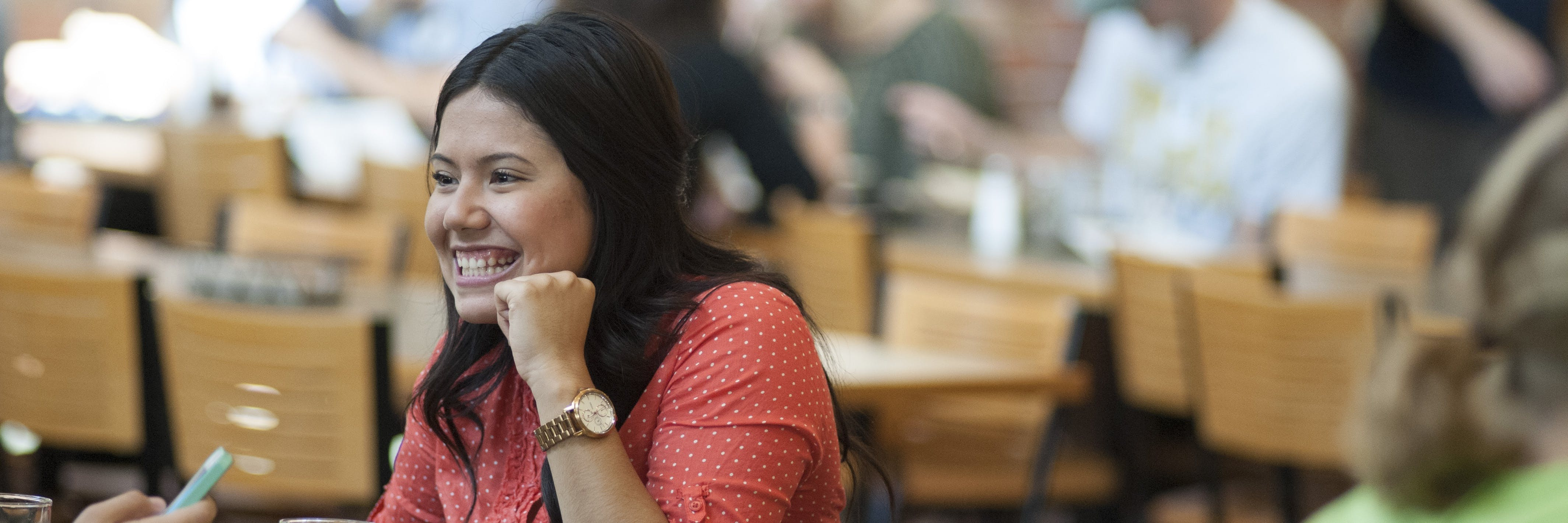 A student smiles at the Monson Dining Center.