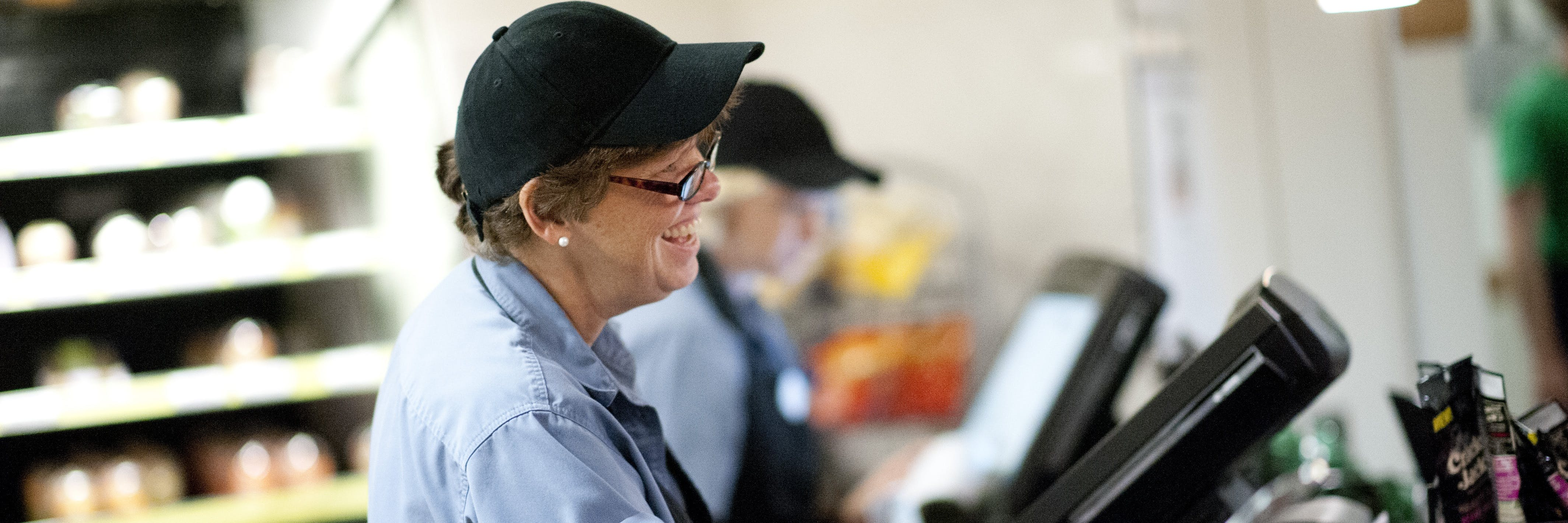 A 3900 Grill staff member smiles.