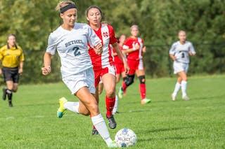 Bethel soccer player kicks the ball