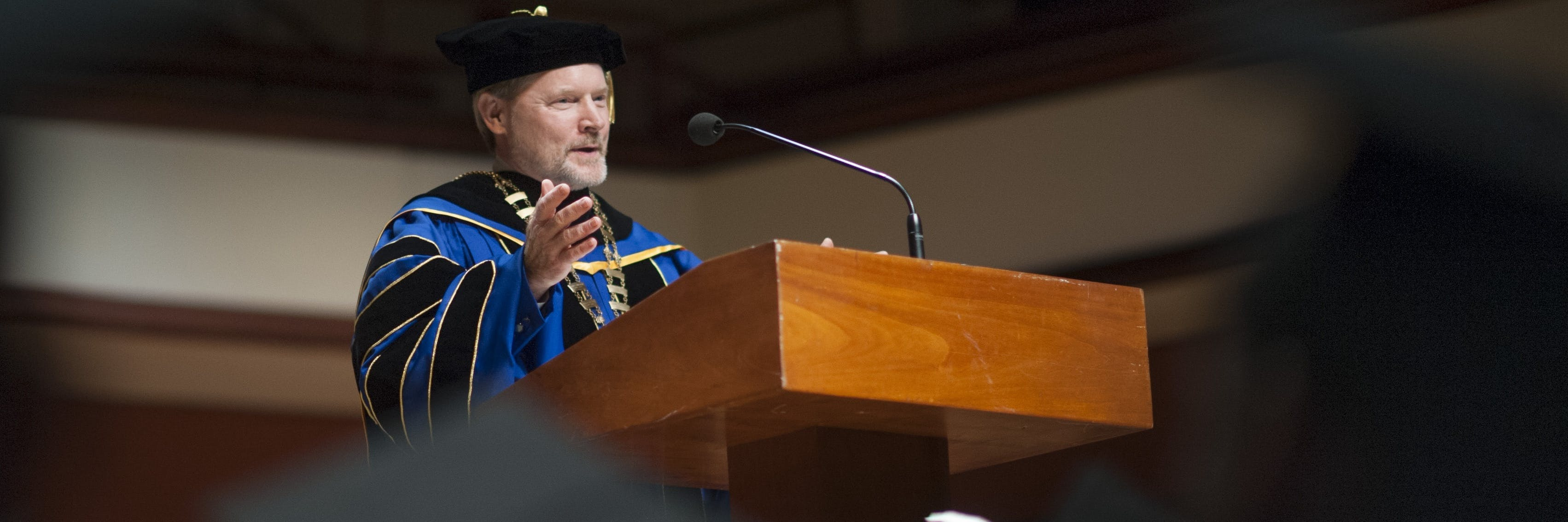 President Jay Barnes speaking at the commencement ceremony