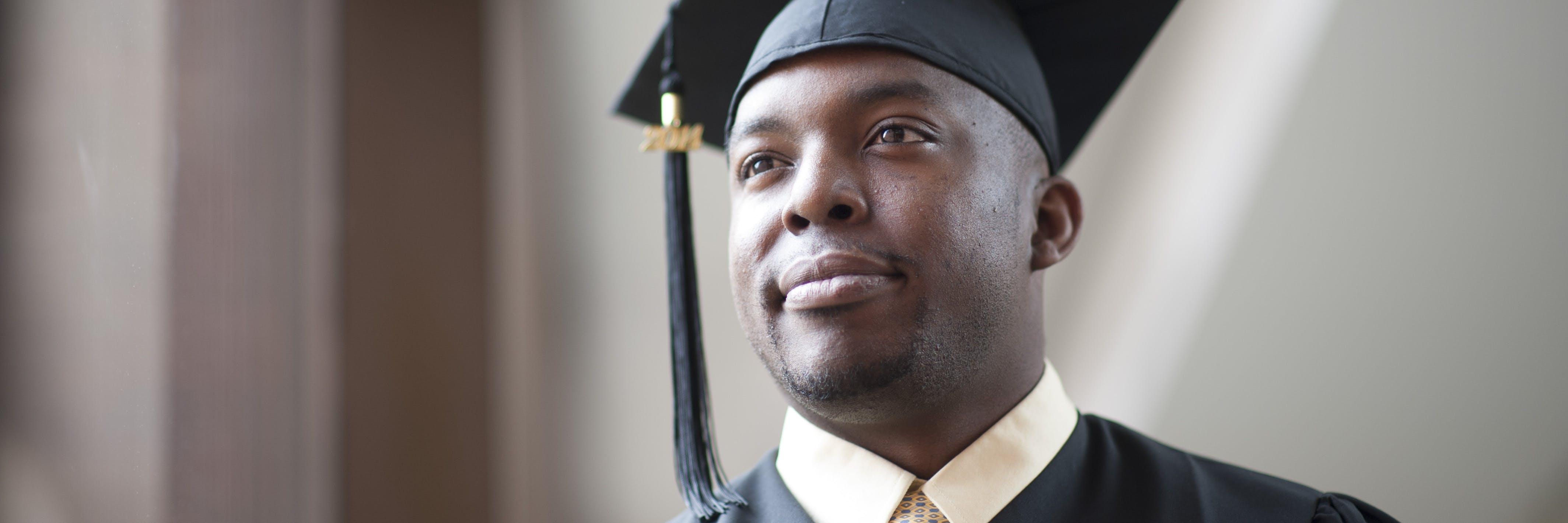 A graduate student smiling
