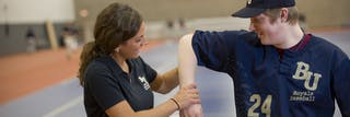 Athletic trainer working with Bethel University athlete