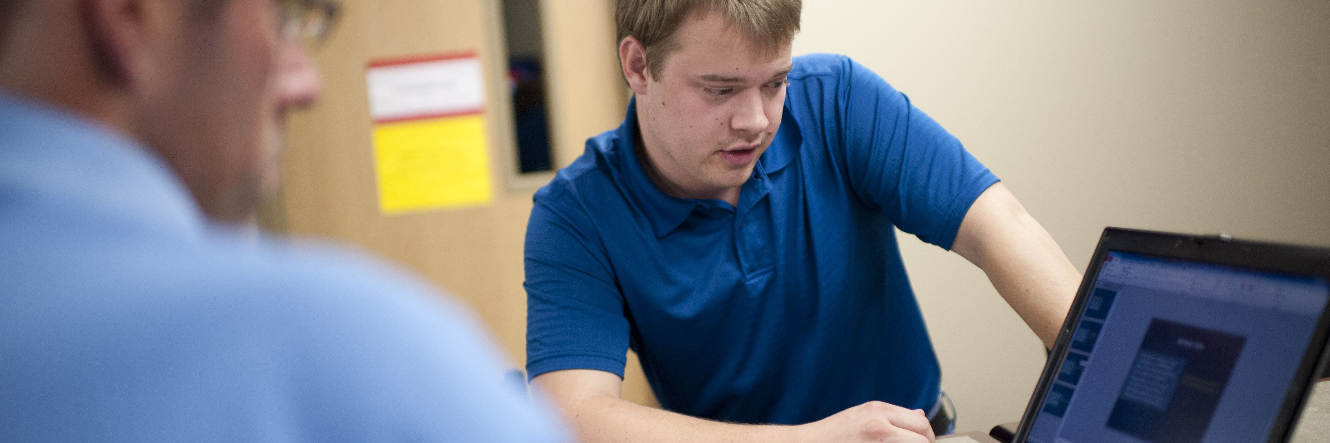 Students works on computer in athletic training class at Bethel University