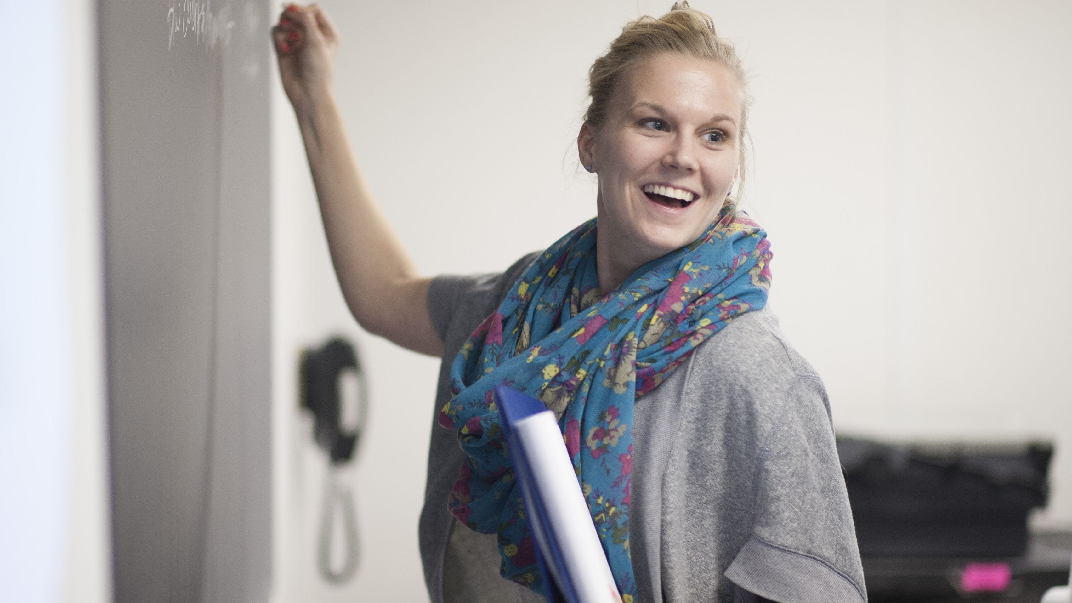 A student participates in a class activity.