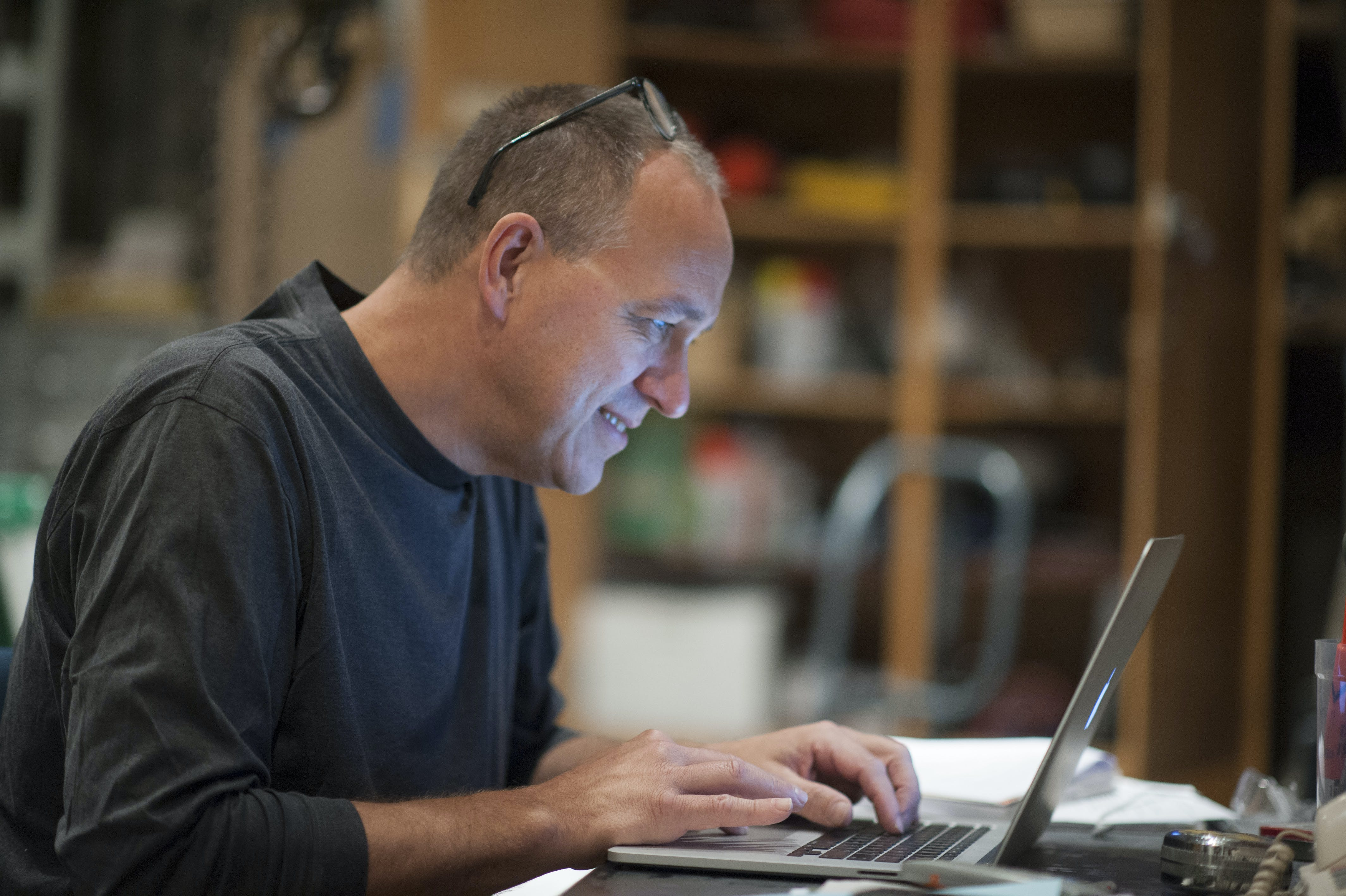 Faculty member on computer