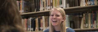 Laughing woman in the stacks