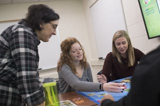 Education students work together in a classroom