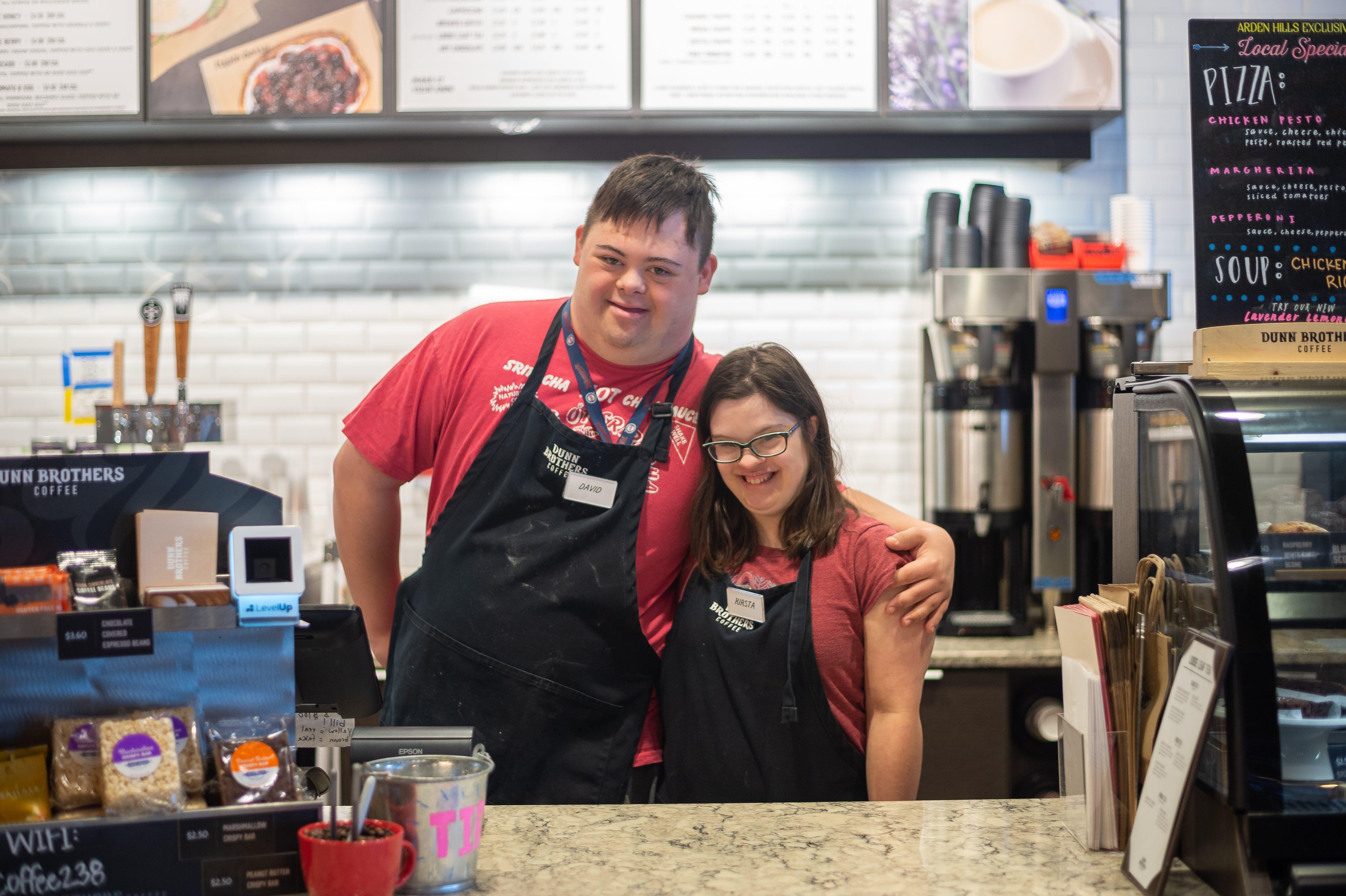 BUILD students David Kaetterhenry and Kirsta Graf at their internship at Dunn Brothers Coffee