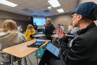 Students use iPads to present in class