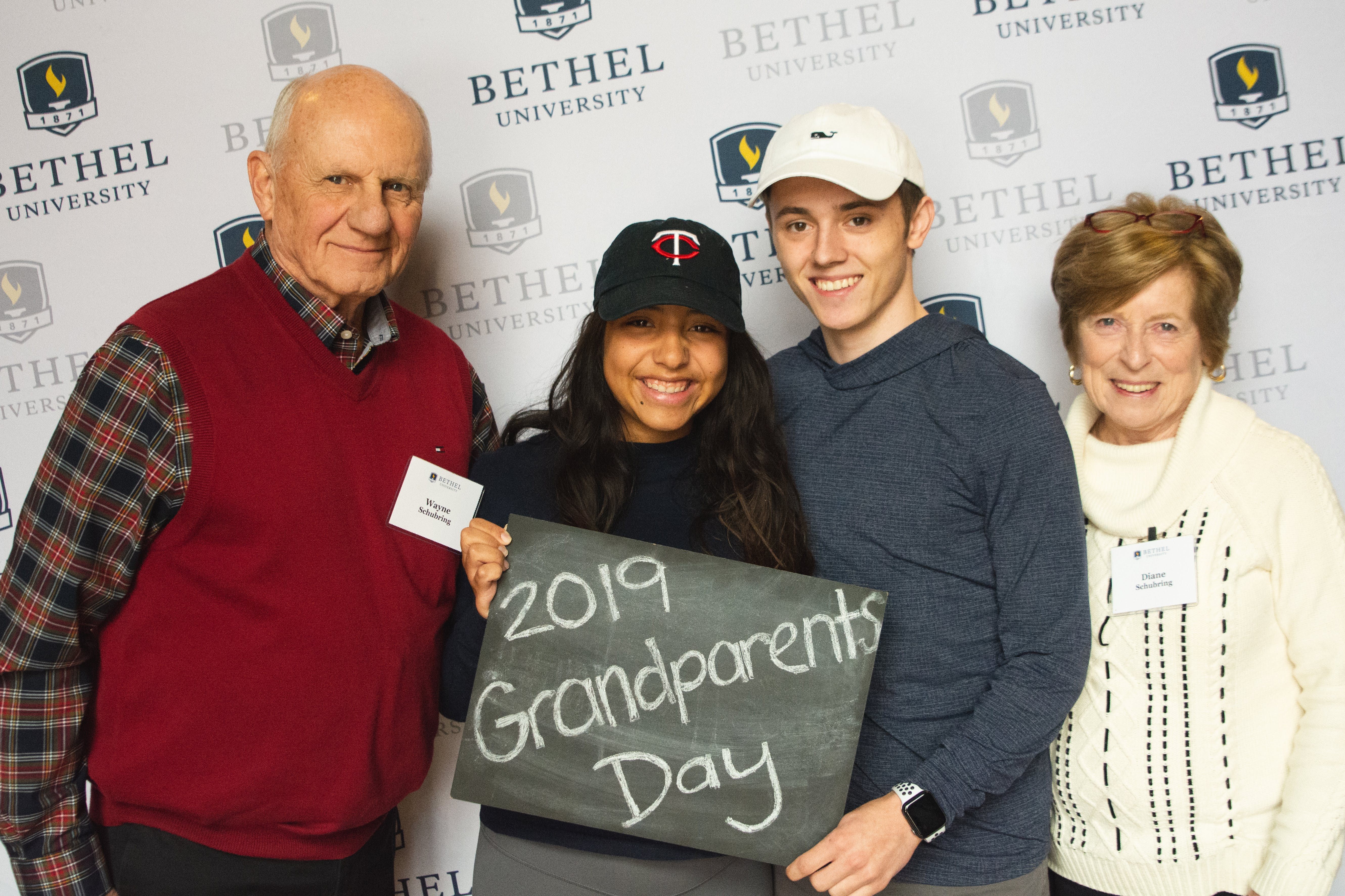 Bethel students and grandparents smile for a photo