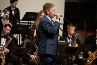Krister singing at fall jazz concert