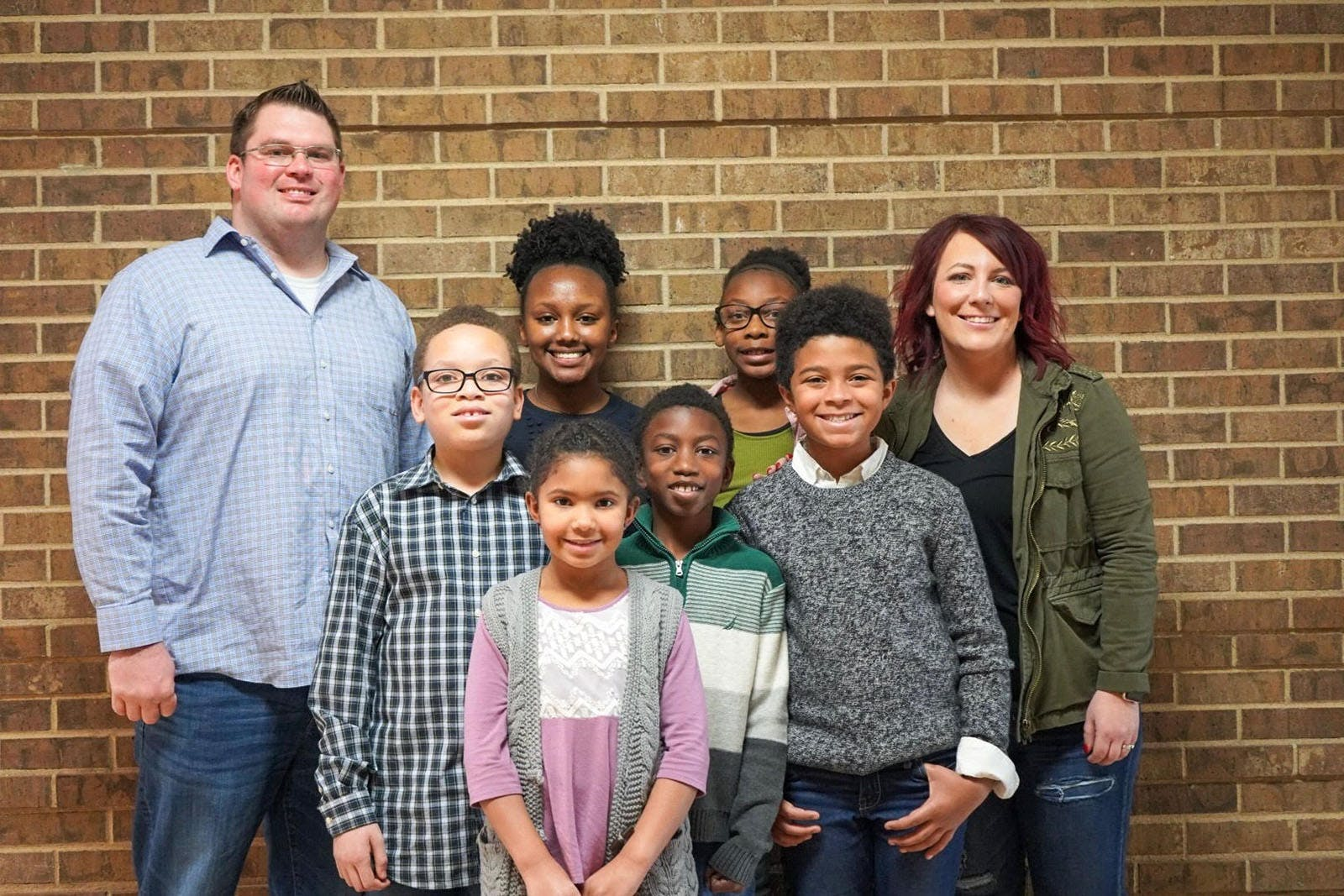 Lucy Swanson poses for a picture with her family. Swanson graduated from Bethel's College of Arts and Sciences and Bethel Seminary.