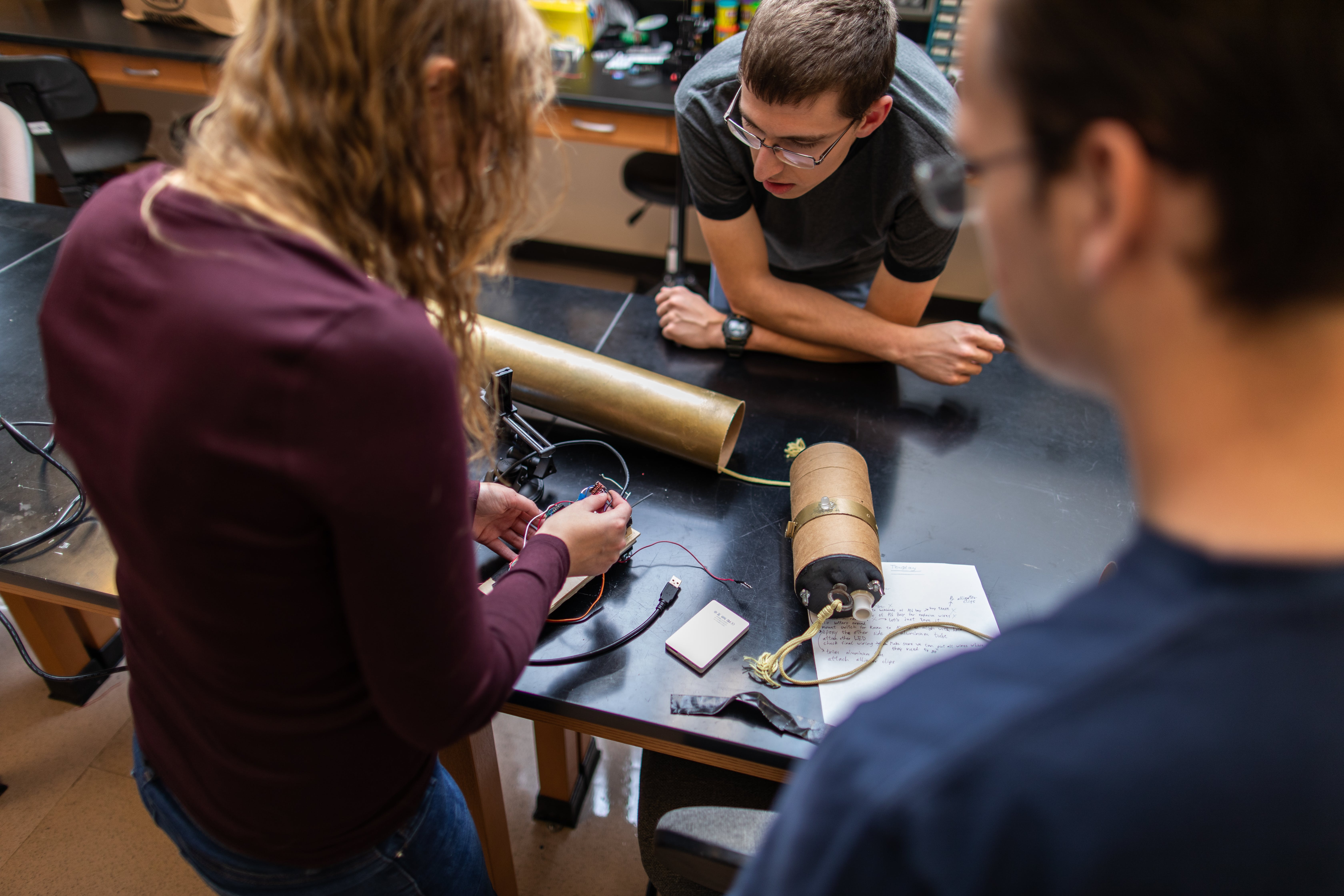 Rocket Club members assemble components in Bethel's Electrical Engineering Lab