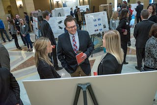Bethel students present their research in the rotunda at the Minnesota state capitol building.