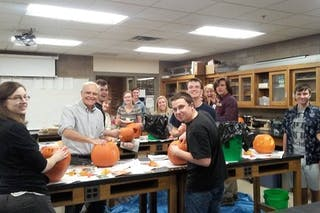Bethel's Society of Physics Students (SPS) chapter at a pumpkin carving Halloween party. (Photo Credit: Provided by Aaron Coe and Alyssa Hamre)