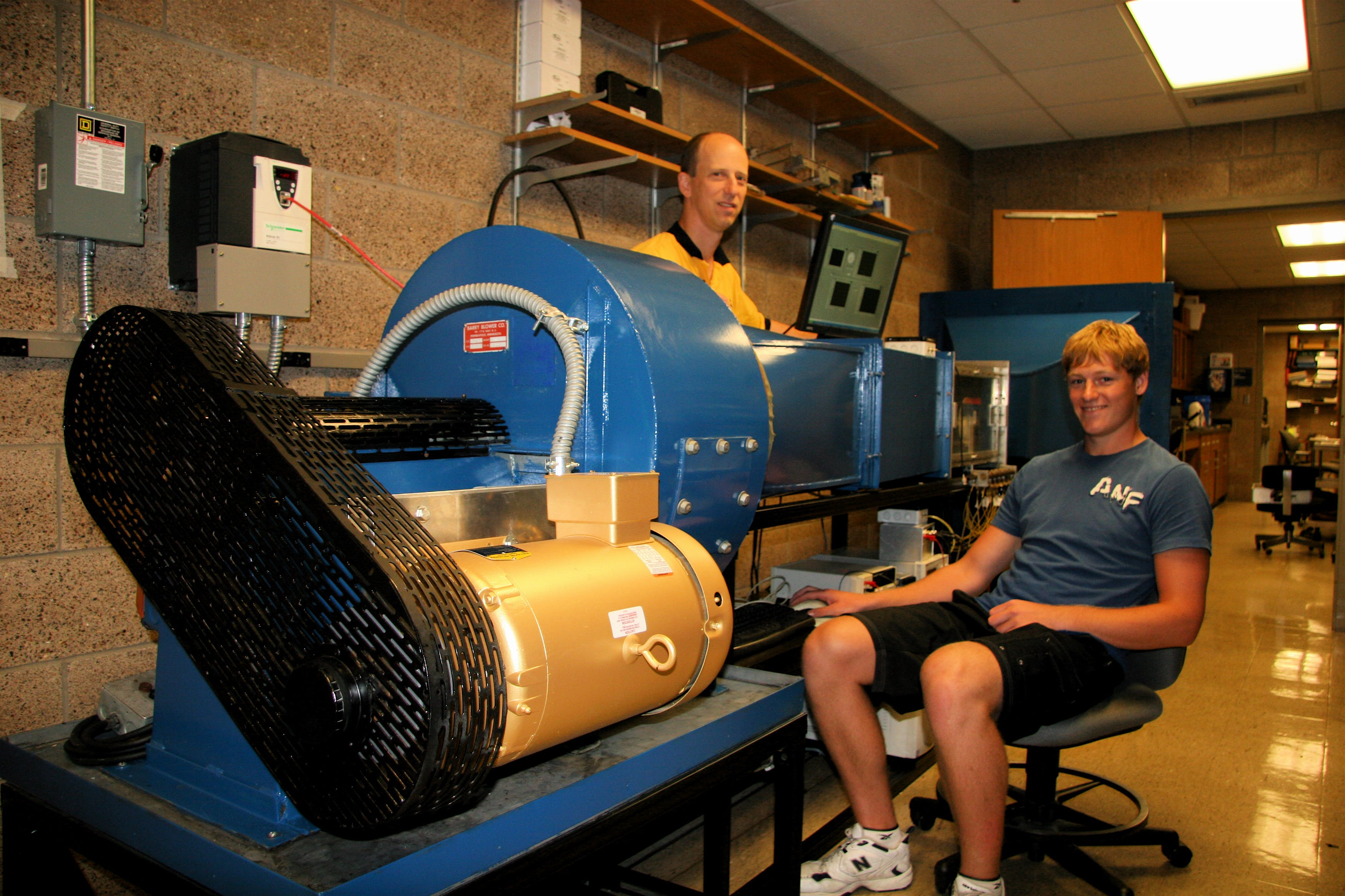 Underland as a student, working with Professor of Physics Keith Stein on the installation and refurbishment of Bethel's wind tunnel during the summer of 2010.
