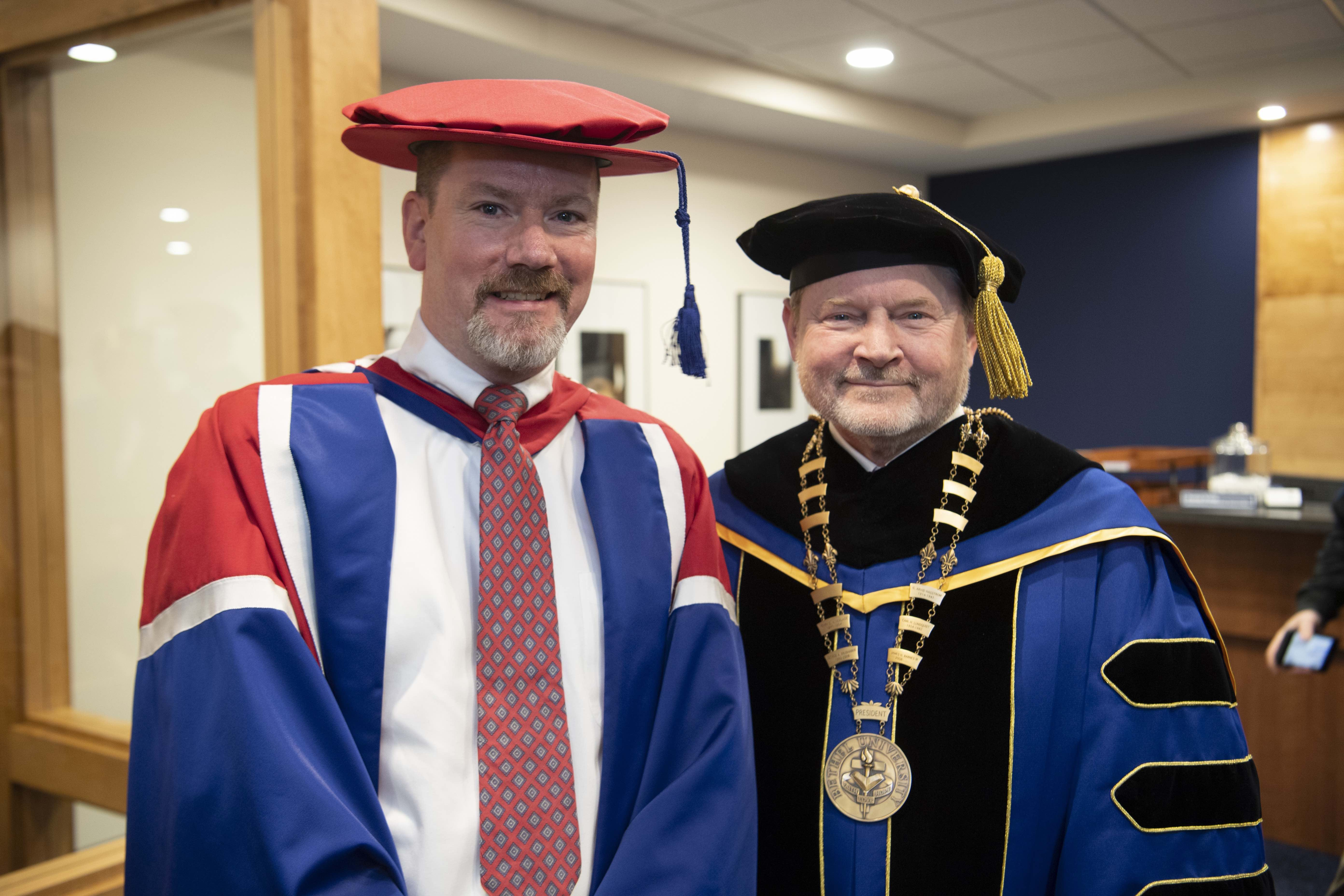 Peter T. Vogt S'97, a former Old Testament faculty member, was installed as dean of Bethel Seminary on February 4. Vogt, left, stands with Bethel University President Jay Barnes before the service.