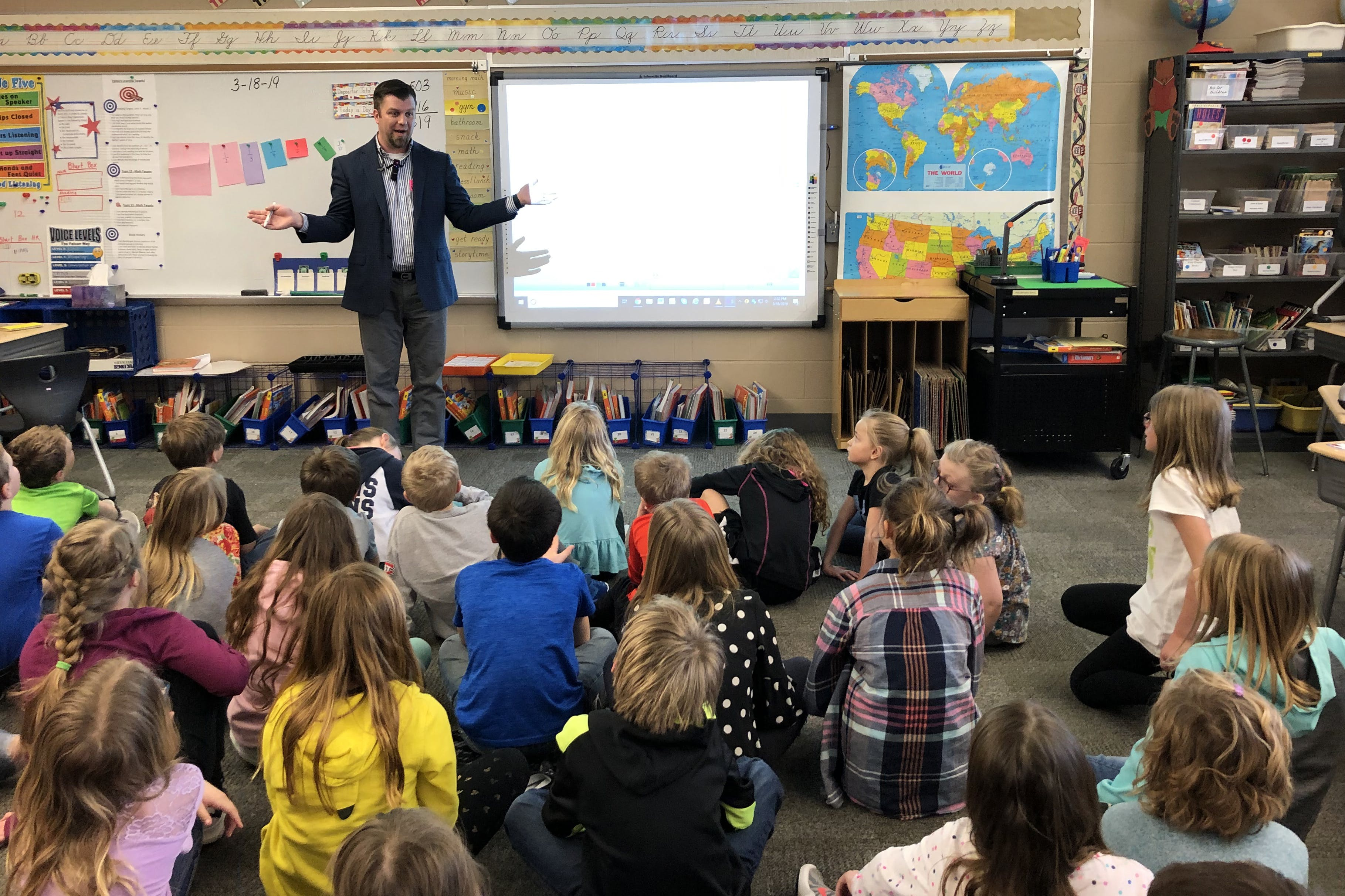 Associate Professor of Chemistry Brandon Winters shares with Foley Elementary third-graders about his Interim trip to Ecuador and the Galápagos Islands.