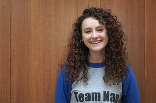 Student Employee of the Year award winner, Elizabeth McClure, wearing her Dining Center team shirt during finals week.