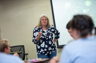 Professor Peggy Kendall teaches high school students that attended Living the Questions in 2019.