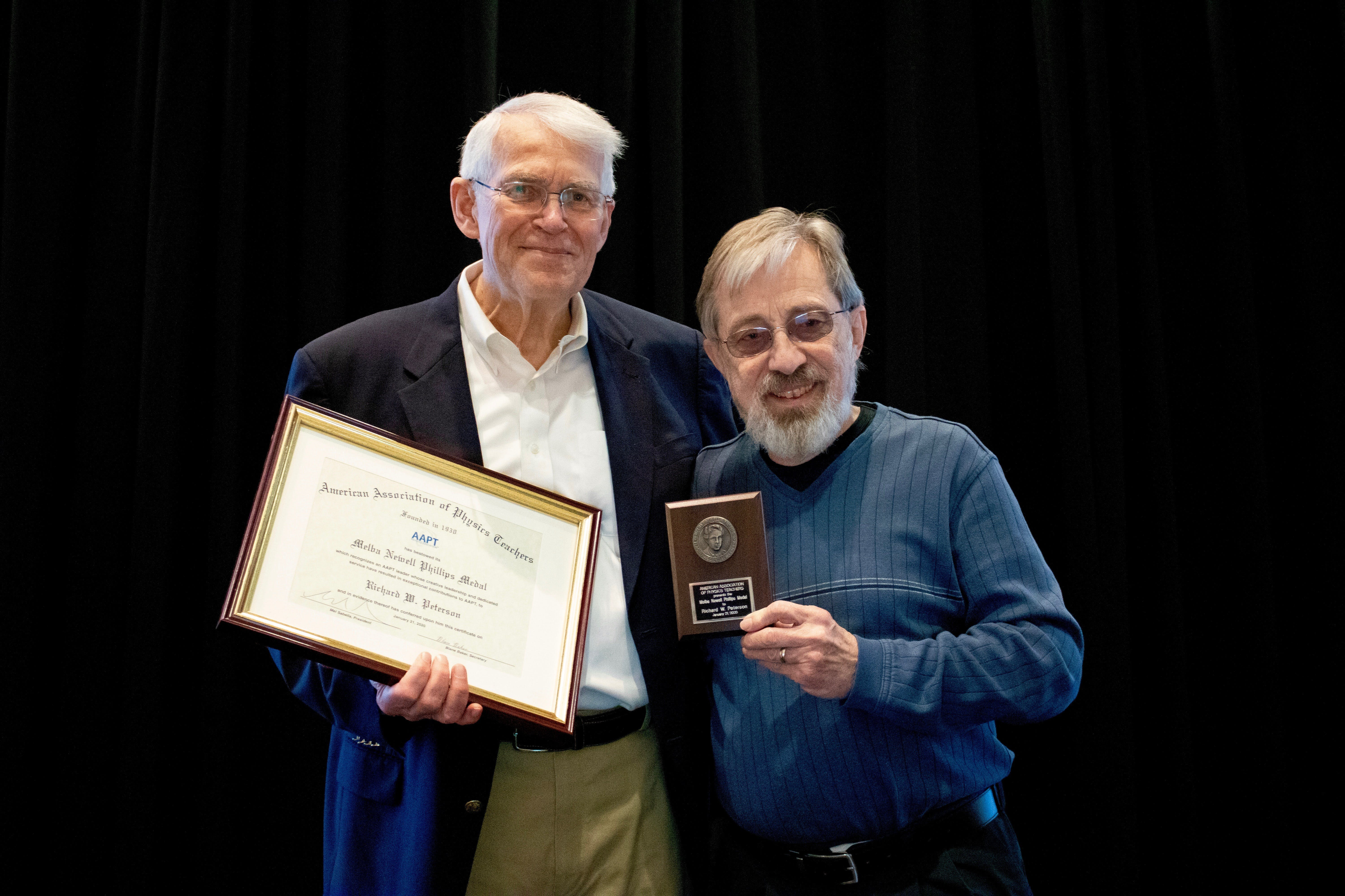 Peterson is presented the Melba Newell Phillips Medal by fellow former AAPT President Gordon Ramsey at the Orlando Winter Meeting.