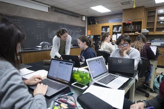 Professor of Biology Sara Wyse works with students in a science classroom at Bethel University.