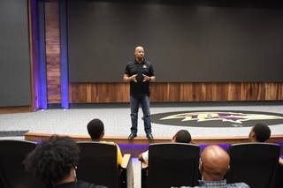 Steve Fitzhugh GS'23 speaks at the Baltimore Ravens' headquarters.