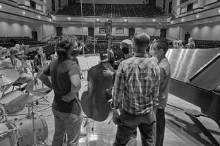 Professor of Music Jason Harms led student musicians through the recording process in Benson Great Hall last December.