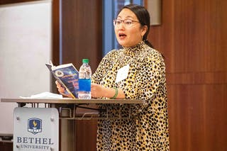 """Before the event, award-winning Hmong-American author Kao Kalia Yang tweeted, """"First in-person talk in over a year. Since 2008, I have not had such a stint away from a podium. Here we go, @BethelU."""""""