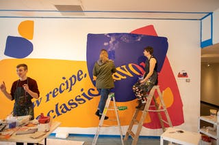 Students in Professor of Art Amanda Hamilton's advanced painting class complete a mural in response to Kent's work.
