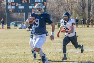 Quarterback Jaran Roste '20 rushes the ball in the Bethel football team's 41-14 win over Wartburg on Saturday. Roste ran the ball 10 times for 150 yards as the Royals racked up 387 rushing yards.