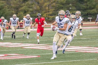 Bethel's Jon Pytlak '20 turns downfield after catching what would end as a 72-yard touchdown in the second quarter of the Royals 27-24 win against North Central College in Naperville, Illinois, on November 24.