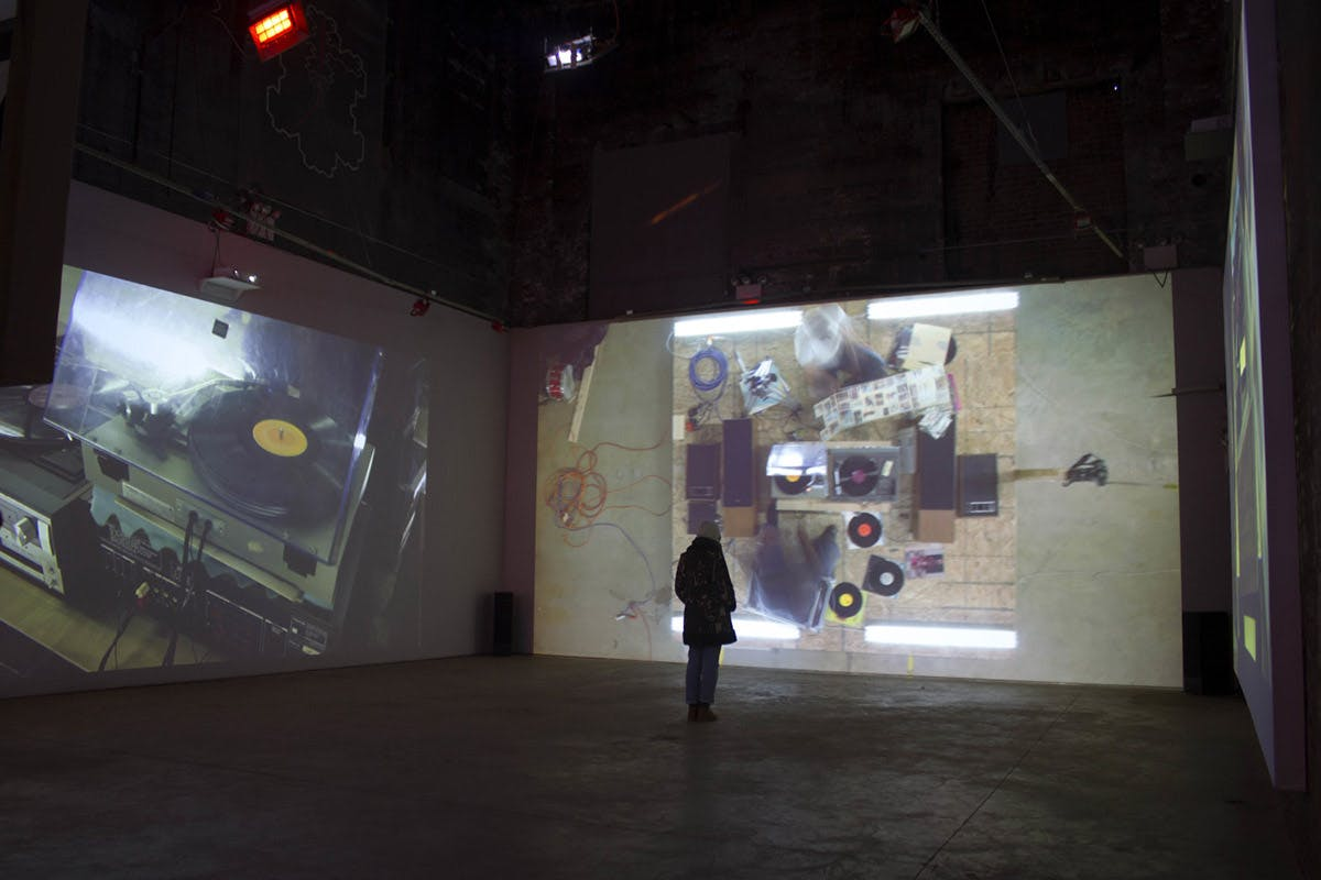 The Raft is comprised of four video projections on the walls of a room: an overhead, two on the raft, and one of the Mississippi River.