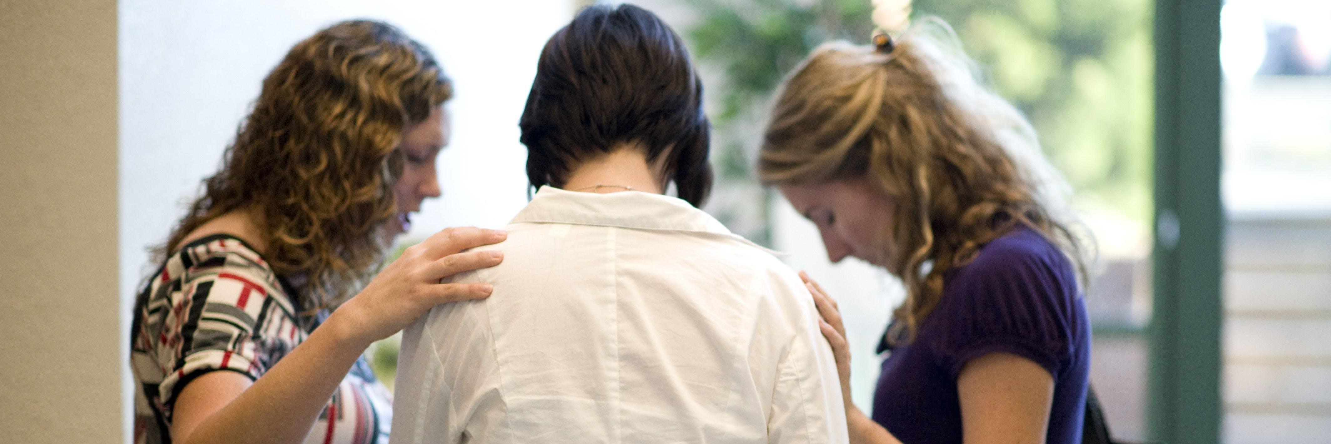 Seminary students praying