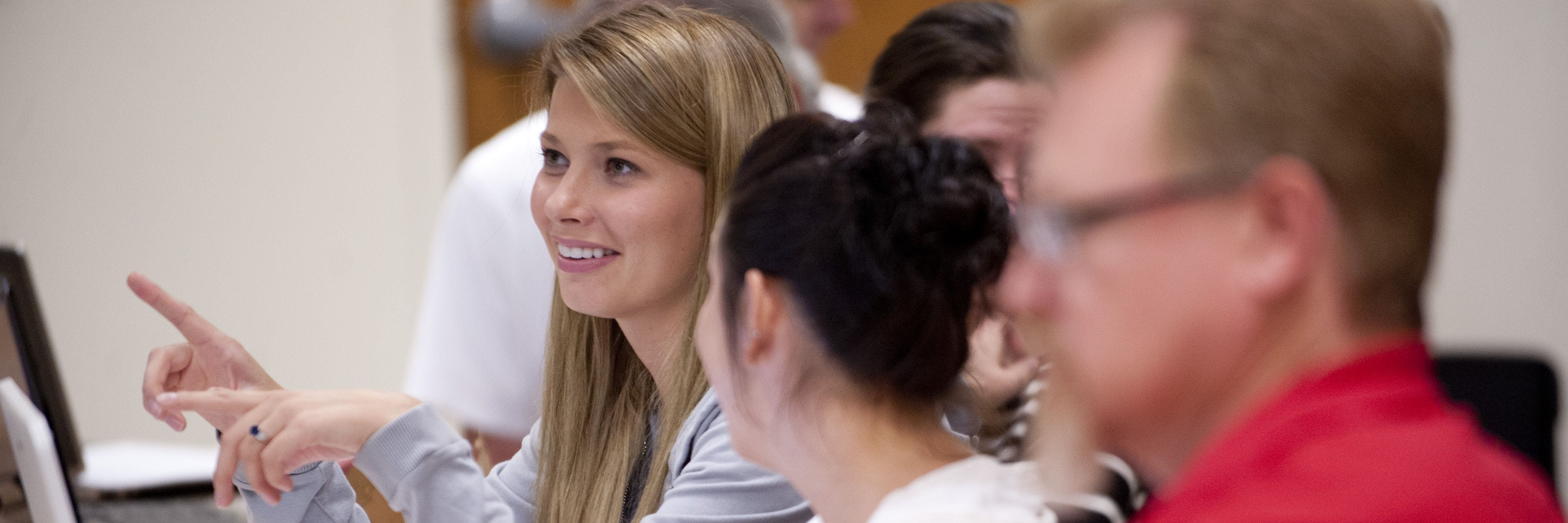 A student participates in class discussion.
