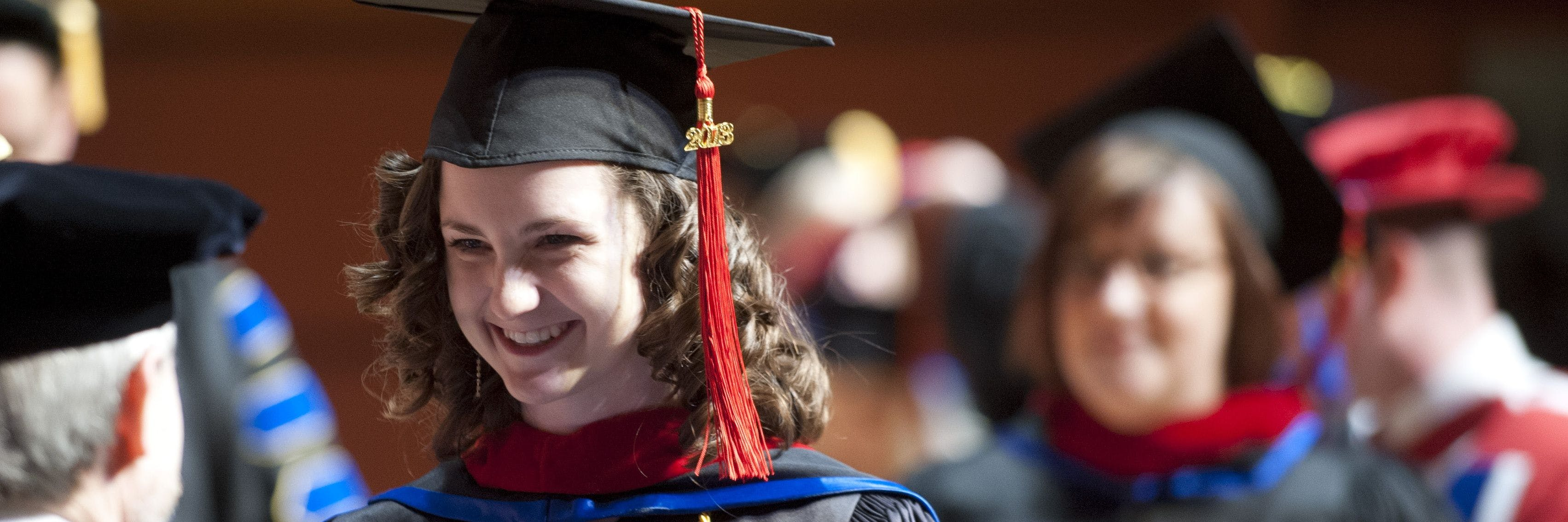 A student graduates from Bethel Seminary in St. Paul.