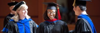 Student smiles during graduation ceremony