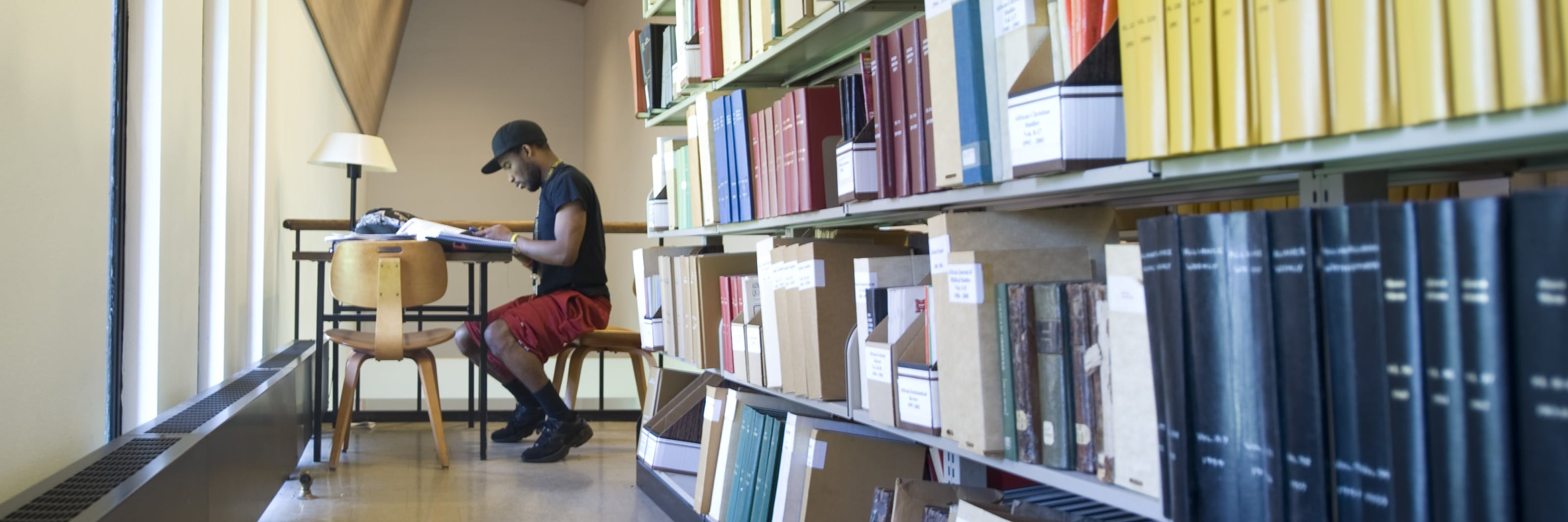 Student studying in the Seminary library.