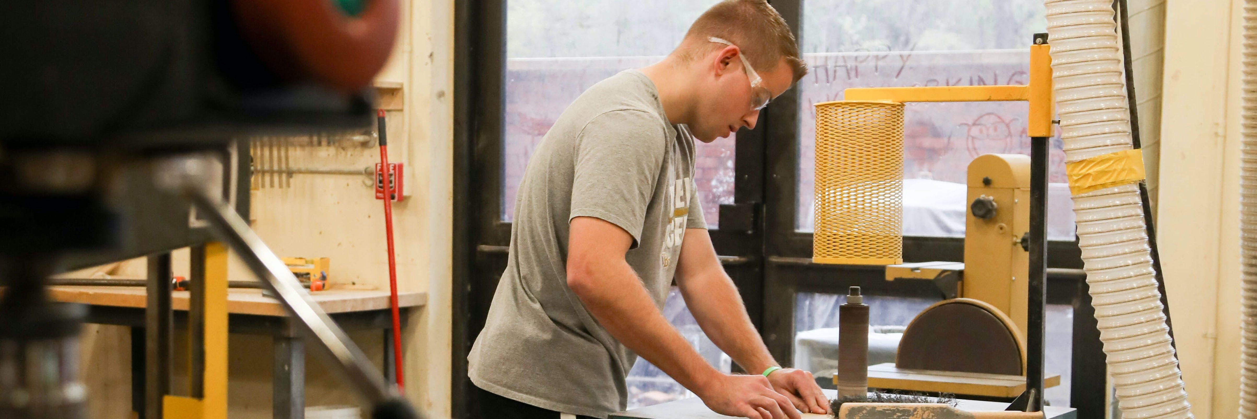 student making wood-cut
