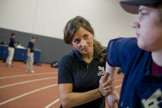 Athletic Training student helping an athlete.