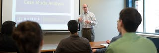 Professor teaching accounting and finance to students.