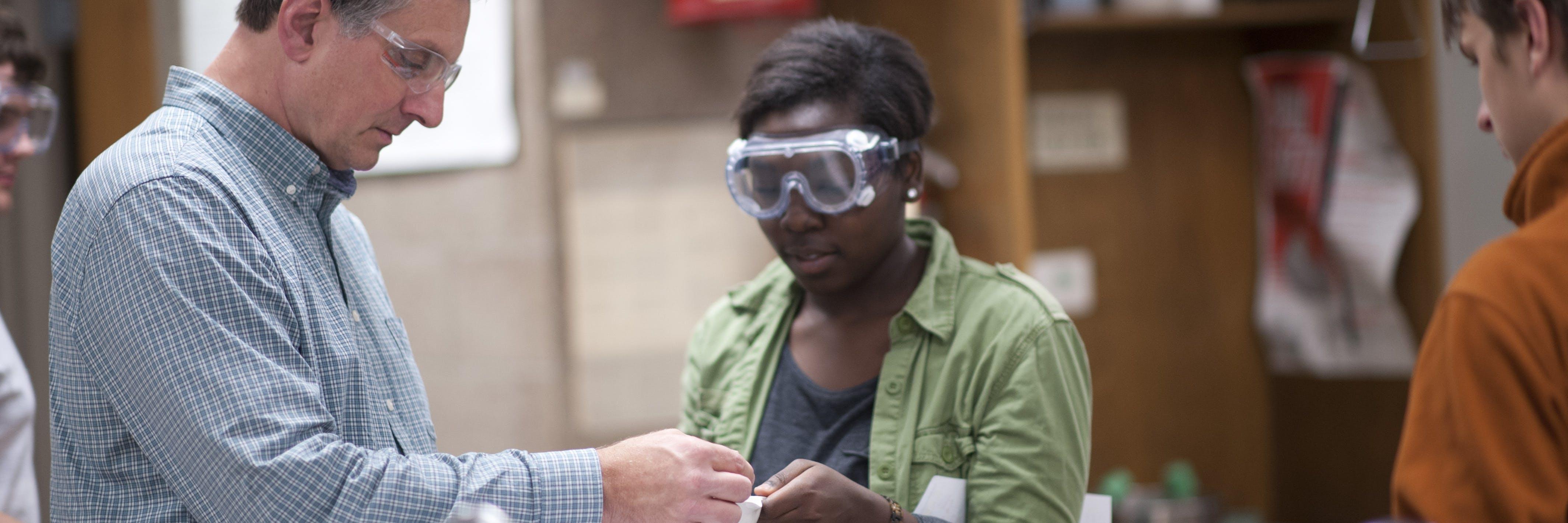 A professor helping a student